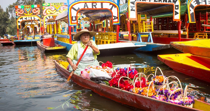 In the area of Xochimilco, Mexico City, locals transport flowers through their canals.