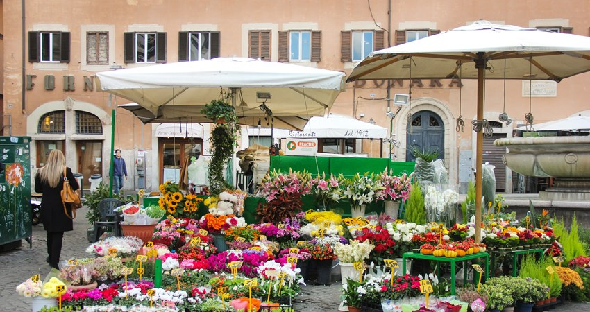 To celebrate spring, visit the Campo de Fiori Flower Market in Rome and also enjoy a nice snack.
